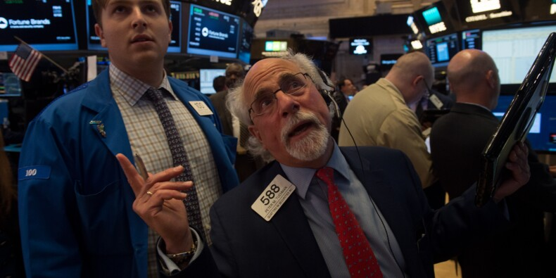 Wall Street finit divisée