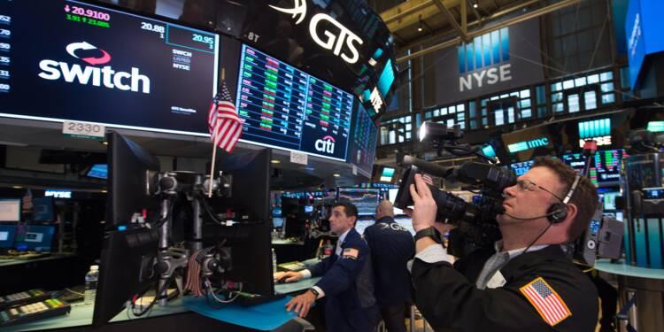 Wall Street, lestée par des résultats mitigés, termine en baisse