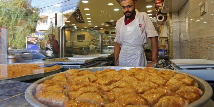 Réfugié en Jordanie, un pâtissier syrien vend les douceurs de son pays