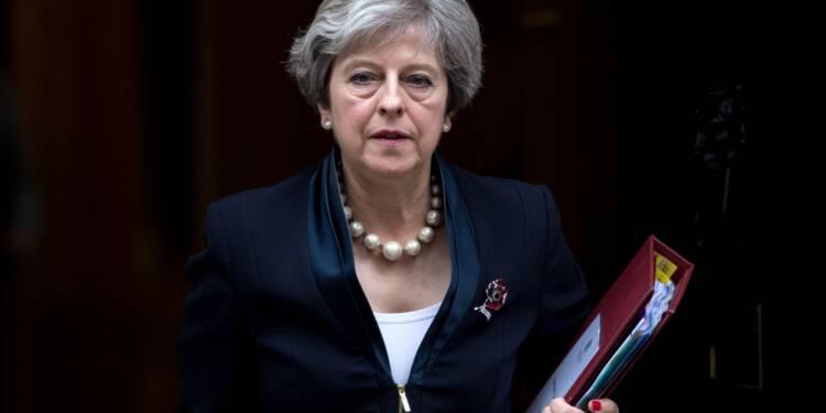 Brexit: May remporte de justesse une première manche au Parlement