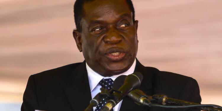 Zimbabwe: le vice-président limogé de retour, Mugabe s'accroche