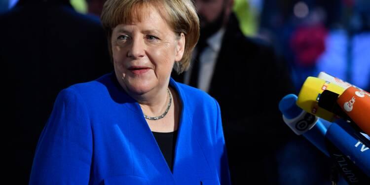 Allemagne: Merkel arrache un accord de principe pour un gouvernement