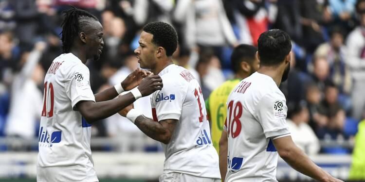 Ligue 1: Lyon et Memphis poursuivent leur marche en avant