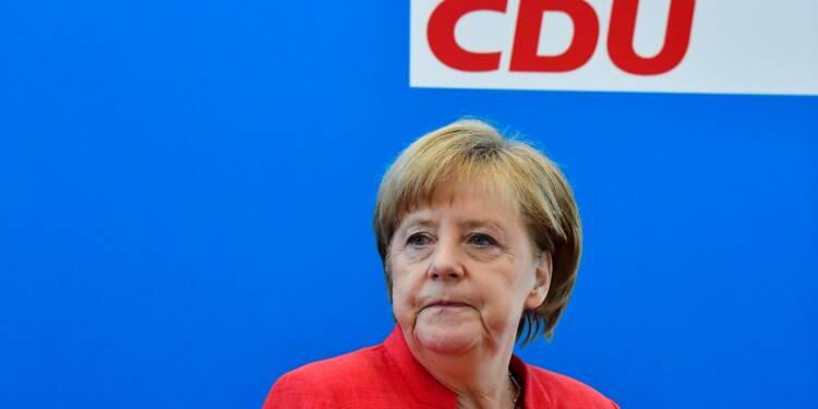 Migrants: Merkel sous pression des durs de son gouvernement et de Trump