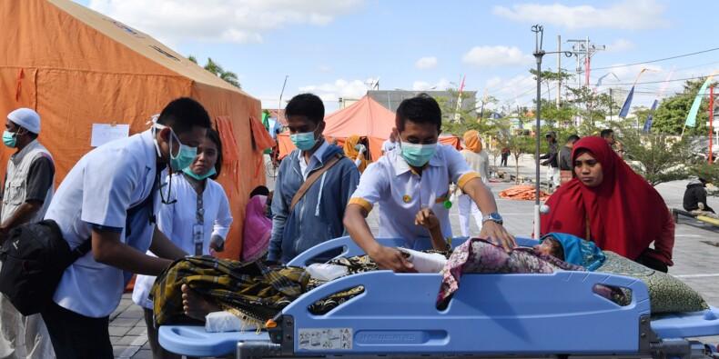 Séisme en Indonésie: au moins 82 morts, les secours à la recherche de survivants