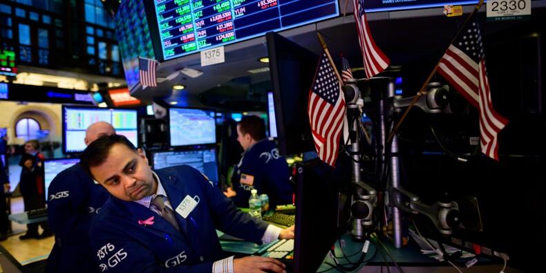 Wall Street ouvre en baisse après des indicateurs mitigés