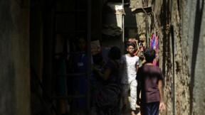 À Bombay, le bidonville de Dharavi fait de la résistance