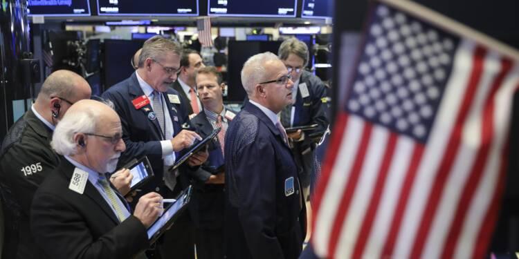 Wall Street en dents de scie, hésitant entre le commerce, l'emploi et Apple