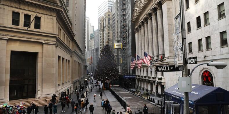 Wall street, en baisse, respire après la réforme fiscale