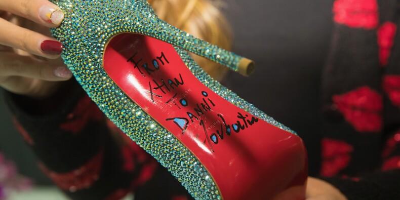 Louboutin garde l'exclusivité de ses semelles rouges