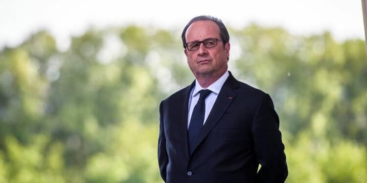 Hollande préside l'hommage au policier tué sur les Champs-Elysées