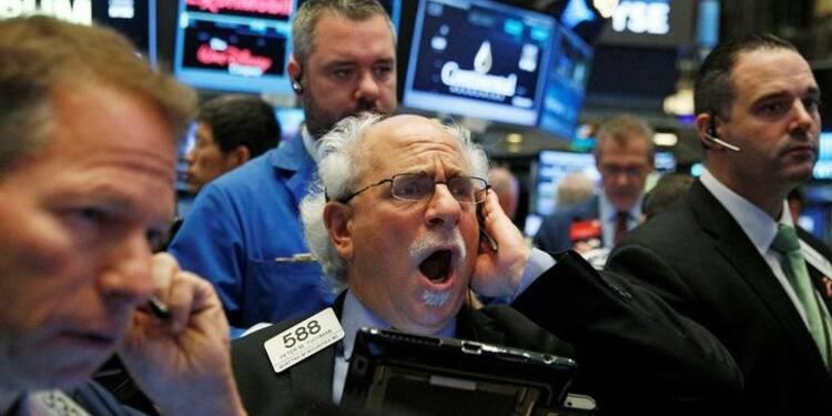 Wall Street termine quasi-stable, animée par des fusions