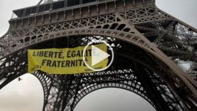 Greenpeace : la vidéo des militants qui escaladent la tour Eiffel et accrochent une banderole anti-FN