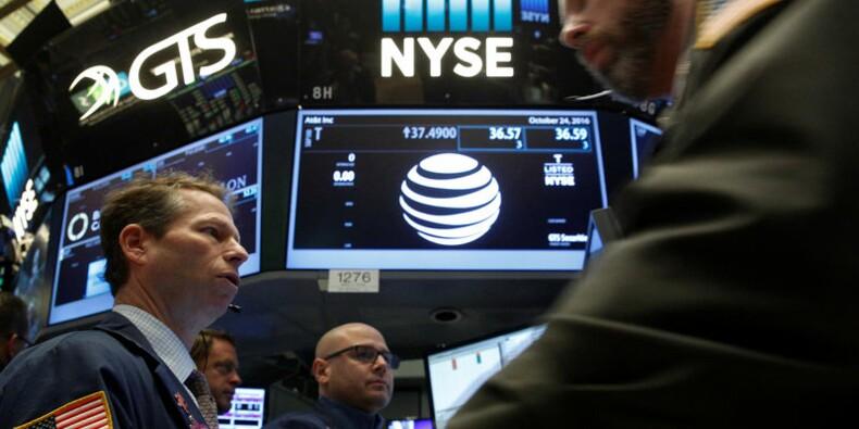 Wall Street profite des résultats et des fusions et acquisitions