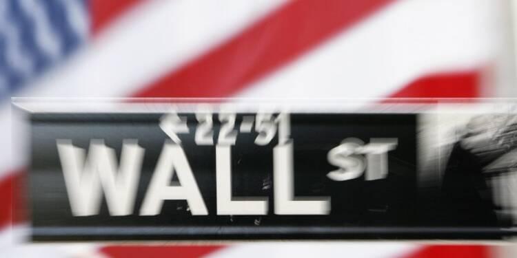 Wall Street finit en hausse, le S&P frôle son record
