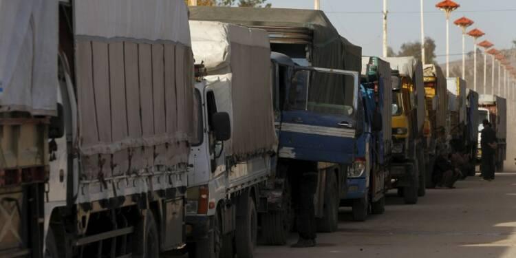 Un convoi humanitaire arrive dans la banlieue de Damas