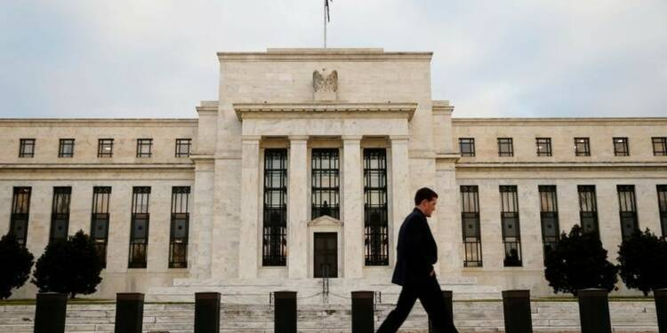 La Fed à contre-courant d'une vague mondiale de baisse des taux