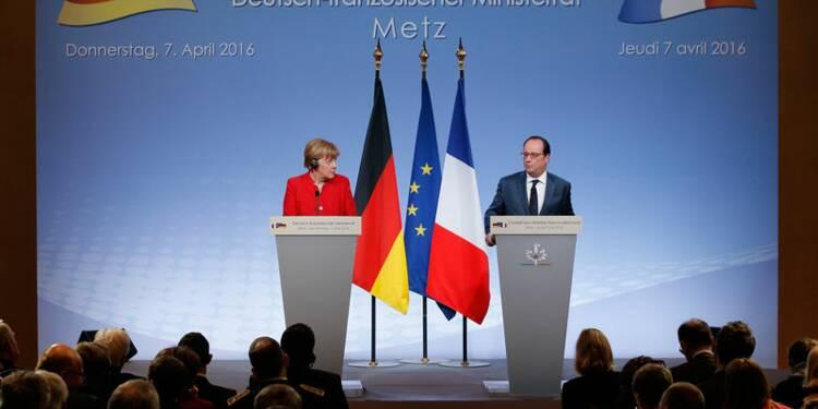Migrants: Hollande et Merkel évoquent un processus en bonne voie