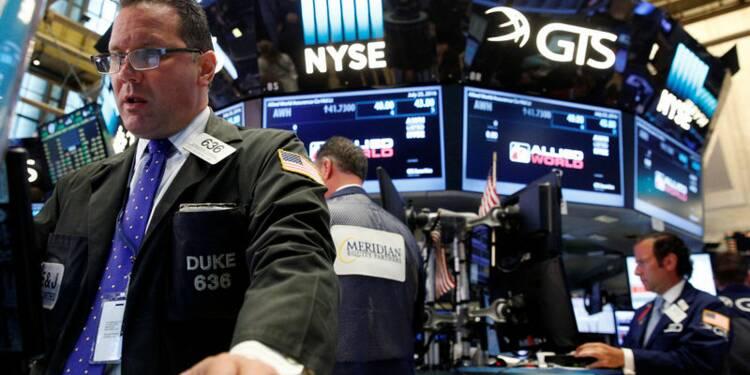 Le Dow Jones finit inchangé, le Nasdaq prend 0,61%