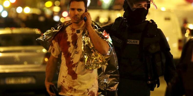 RPT-Les attaques à Paris ont fait au moins 128 morts