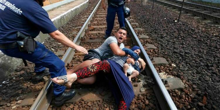 """Hollande et Merkel évoquent des """"initiatives"""" pour les migrants"""