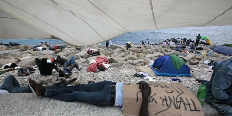 Paris, Rome et Berlin veulent apaiser le conflit sur les migrants