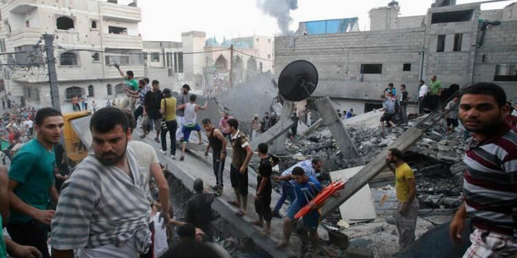 Près de 100 morts à Gaza, Israël promet d'autres raids