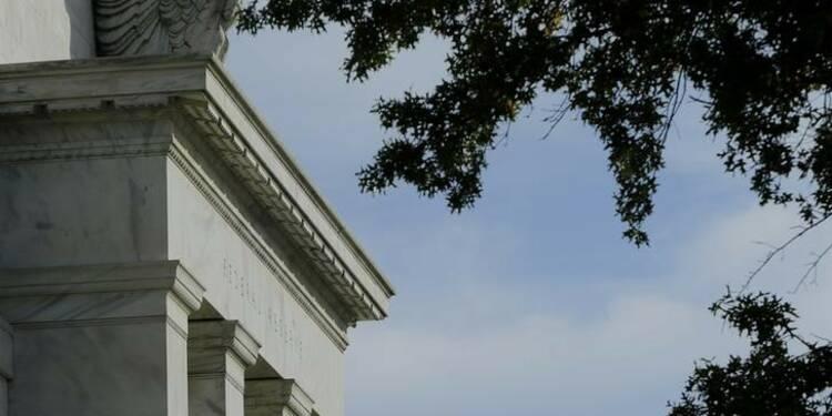 La Fed met fin aux rachats d'actifs mais reste accommodante
