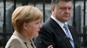 Merkel plaide en Ukraine pour la paix, le convoi en Russie