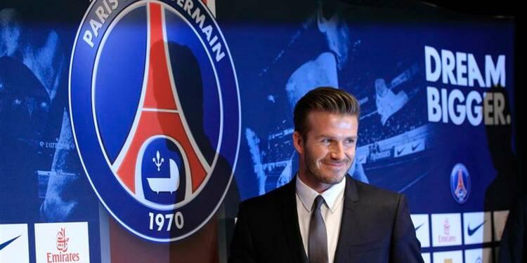 Football: David Beckham arrive à Paris en séducteur