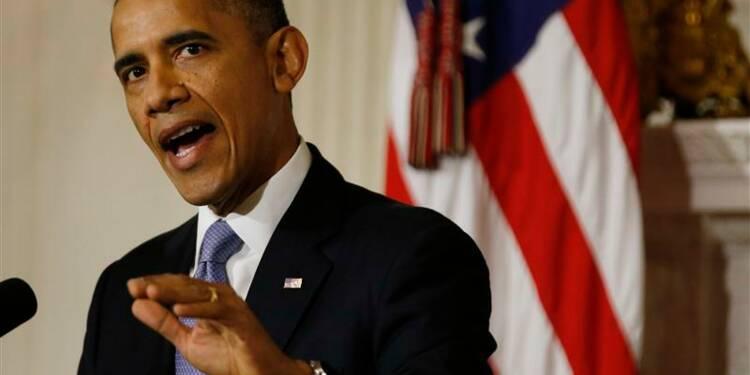 """Obama signe la loi sur la dette et met fin au """"shutdown"""""""
