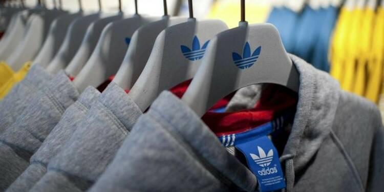Résultats en baisse pour Adidas, fronde des actionnaires