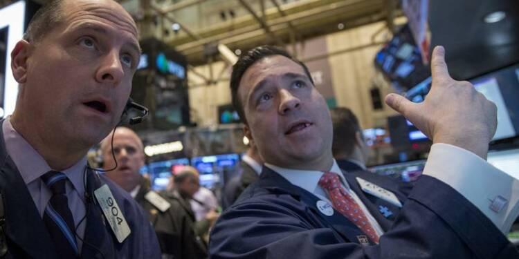 Wall Street débute en léger repli en attendant le Michigan
