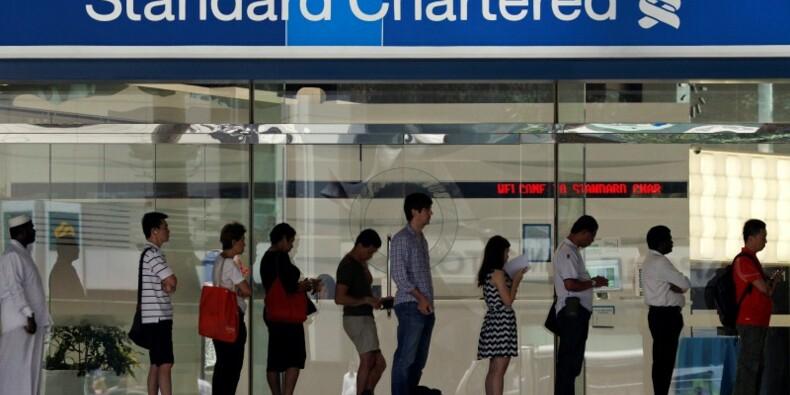 Standard Chartered voit ses résultats baisser d'environ 20%