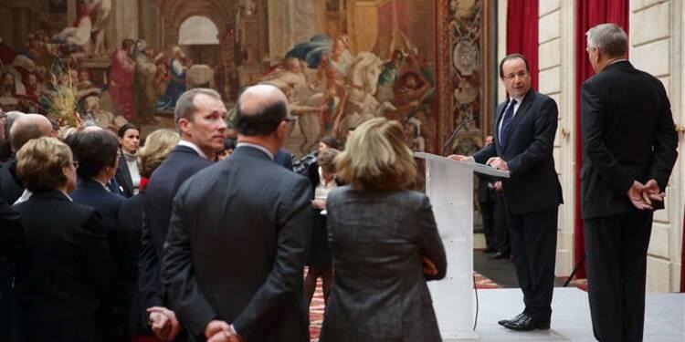 Hollande prie les ministres de se ranger derrière Ayrault