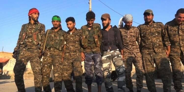A Raqa, des combattants impatients de retrouver leur maison