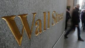 La croissance mondiale inquiète Wall Street qui fléchit