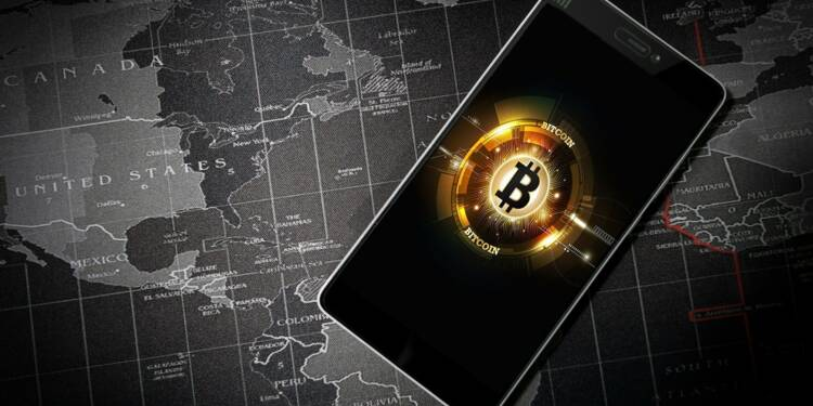 Le bitcoin s'envole à 35.000 dollars, va-t-il faire concurrence à l'or ?
